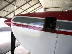 Composite cowling side view with small inspection door.