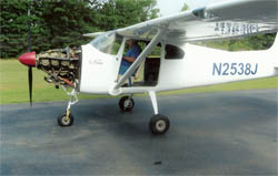 Tom Messender of Parkton, NC, with his 1956 Cessna 182