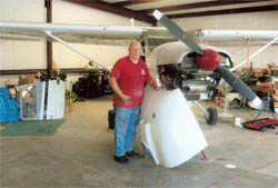 Tom Messeder installing his new Selkirk composite cowling.